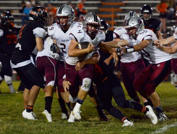 Bear River's Luke Baggett tries to escape a tackle during a game against Marysville earlier this season.