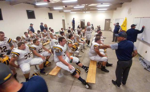 Nevada Union football coaches go over some half time adjustments in the locker room during the Miners win over the Napa Indians.