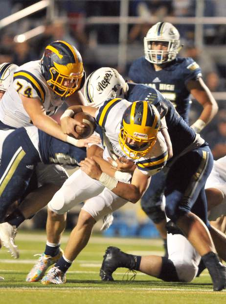 A Nevada Union player is pulled down during a play Friday against the Napa Indians.