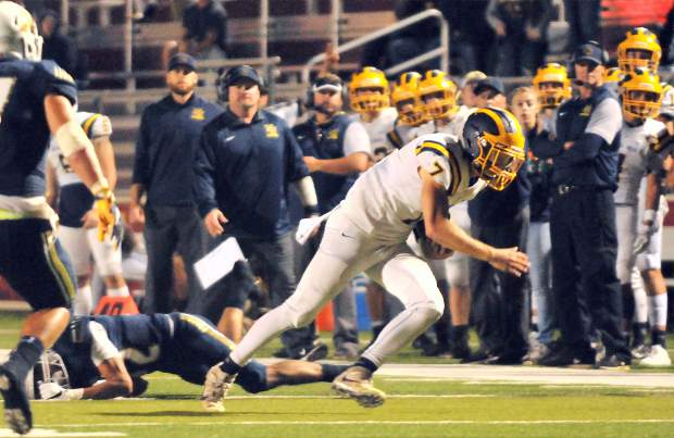 Nevada Union quarterback Owen Dal Bon (7) runs the ball during the Miners non league win against the Napa Indians Friday.