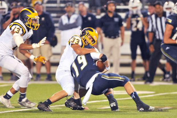 Nevada Union linebacker Duke Morales pulls down Napa's Caden Cortese during Friday's non-league matchup. Morales finished the game with six total tackles, including a sack. The Miners won the game, 14-13