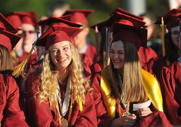 A pair of Bear River graduates share a memory and a laugh during the 2018 graduation ceremonies Friday evening at Bear River High School.