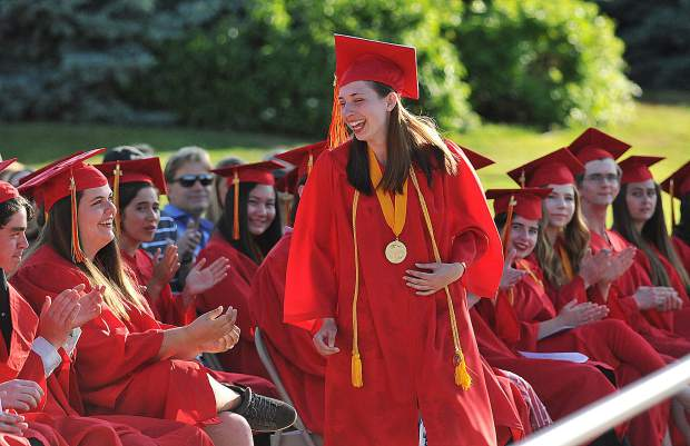 Senior Class President Grace Stubbs walks up to the stage to give the class president address during Wednesday's Ghidotti Early College High School graduation at Sierra College.