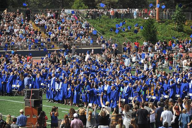 The Nevada Union graduating class of 2018 tosses their hats into the air after being certified graduates Saturday morning at Hooper Stadium.