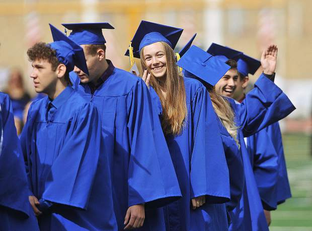 Smiling faces of the Nevada Union graduating class of 2018 look back at their family and friends in attendance of Saturday morning's graduation ceremony.