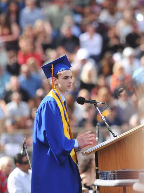 Nevada Union High School valedictorian speaker Ryan Brott, gives his address to his fellow graduating class of 2018 in front of hundreds in attendance at Hooper Stadium during Saturday morning's ceremony.