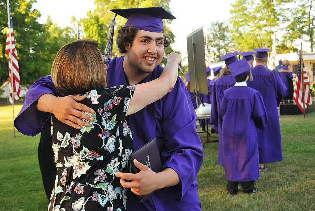 Silver Springs graduate Keaton Rutowski hugs English teacher Tamara Haas after getting his diploma during Thursday's graduation ceremony.