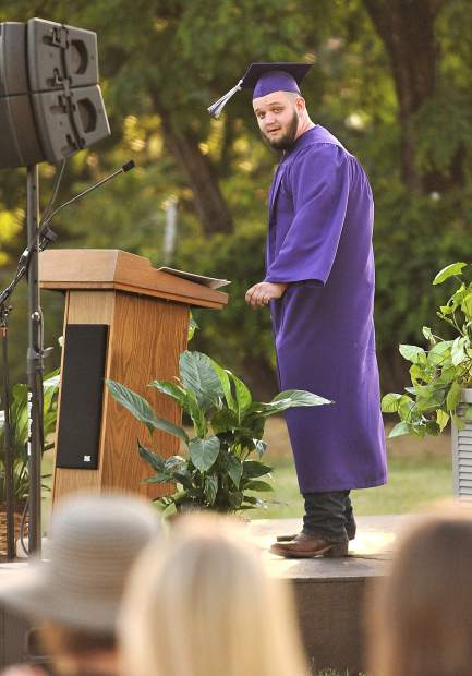 Silver Springs class of 2018 student speaker Matthew Brown looks over to his instructors and thanks them for being such good role models during his address.