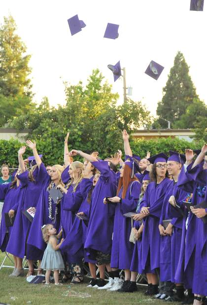 The Silver Springs High School class of 2018 throws their caps into the air after graduating during Thursday's ceremony.