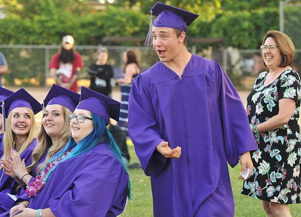 Bobby Joe Prosser is surprised to learn that he is the recipient of a $250 scholarship.
