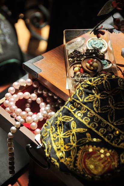 A treasure box of vintage jewelry sits available for customers to pore through at downtown Grass Valley's Vintage on Main store.