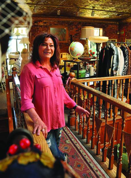 Nevada County's Susan Escano stands on the second floor of her downtown Grass Valley antique store, Vintage on Main. Her collections range from vintage clothing, to antiques and historic items all for sale.