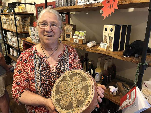 Barbara Jenness, owner of Wheyward Girl Creamery in Nevada City, shows off a wheel of the popular Challerhocker cheese from Switzerland.