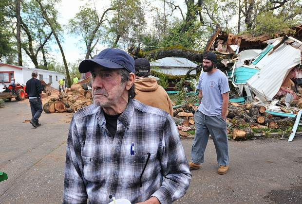 Ralph Magliocca stands in front of his Penn Valley mobile home unit that was crushed by an oak tree that he says he warned Creekside Village management about in advance of the tree falling. Over a year later, park management has done little to help and are now ordering the Magliocca's out of the park if they can't finish the necessary repairs.