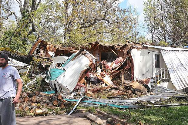 The living room of the Magliocca's Penn Valley mobile home unit sits smashed a day after the oak tree crashed into their home in April of 2017.