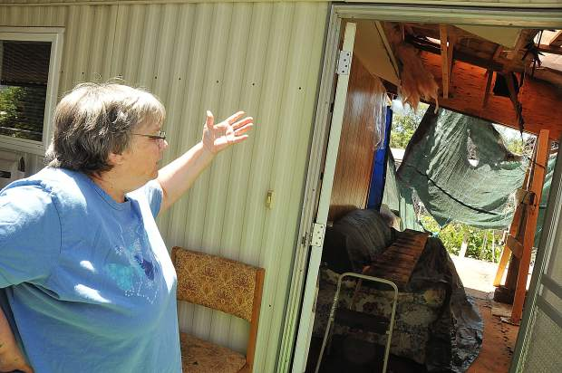 Barbara Magliocca shows the gaping hole left in the living room of her Creekside Village mobile home, damages that she says the owners of the park are culpable for.
