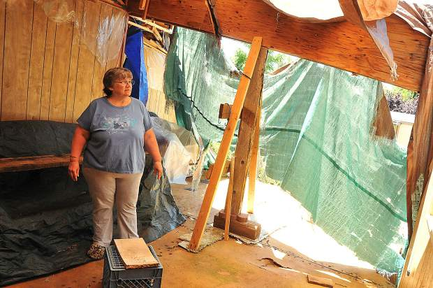Creekside Village mobile home resident Barbara Magliocca stands in the tattered remnants of what used to be the living room of her and husband Ralph's mobile home in Penn Valley after an oak tree came crashing through in April of 2017.