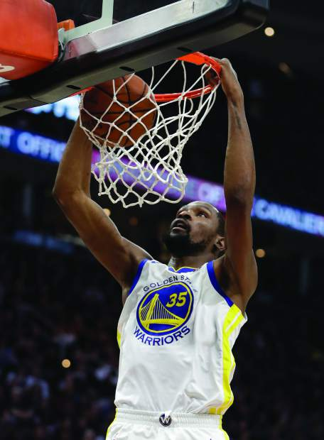Golden State Warriors' Kevin Durant dunks during the first half of Game 4 of basketball's NBA Finals against the Cleveland Cavaliers, Friday, June 8, 2018, in Cleveland. (AP Photo/Tony Dejak)