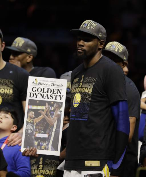 Golden State Warriors' Kevin Durant celebrates after the Warriors defeated the Cleveland Cavaliers 108-85 in Game 4 of basketball's NBA Finals to win the NBA championship, Friday, June 8, 2018, in Cleveland.