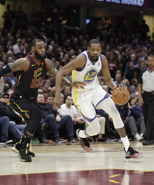 Golden State Warriors' Kevin Durant goes to the basket against Cleveland Cavaliers' LeBron James during Game 4 of basketball's NBA Finals, Friday in Cleveland. Durant recorded a triple-double in the win and was named the NBA Finals MVP.