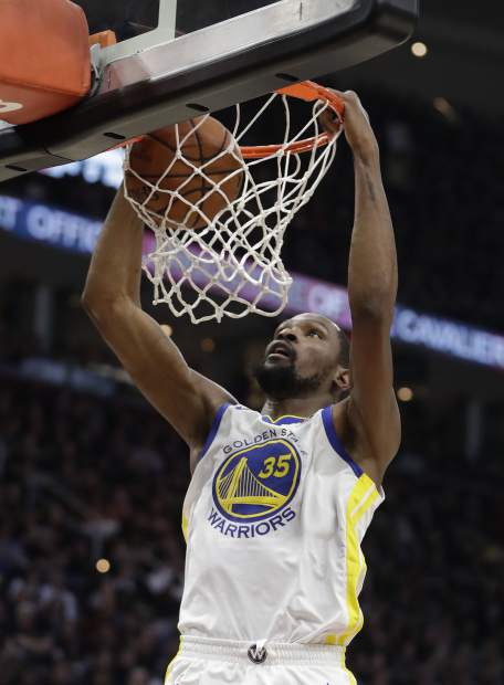 Golden State Warriors' Kevin Durant dunks during the first half of Game 4 of basketball's NBA Finals against the Cleveland Cavaliers, Friday, June 8, 2018, in Cleveland.