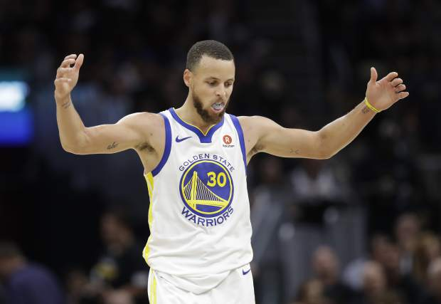 Golden State Warriors' Stephen Curry celebrates in the second half of Game 4 of basketball's NBA Finals against the Cleveland Cavaliers, Friday, June 8, 2018, in Cleveland. (AP Photo/Tony Dejak)