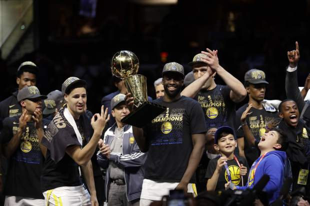 Golden State Warriors' Draymond Green celebrates after the Warriors defeated the Cleveland Cavaliers 108-85 in Game 4 of basketball's NBA Finals to win the NBA championship, Friday, June 8, 2018, in Cleveland.