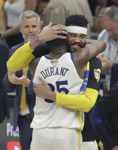 Golden State Warriors' Kevin Durant (35) and JaVale McGee celebrate following Game 4 of basketball's NBA Finals, Friday, June 8, 2018, in Cleveland. The Warriors defeated the Cavaliers 108-85.