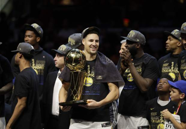 Golden State Warriors' Klay Thompson celebrates after the Warriors defeated the Cleveland Cavaliers 108-85 in Game 4 of basketball's NBA Finals to win the NBA championship, Friday, June 8, 2018, in Cleveland.