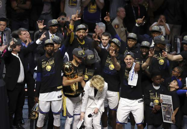 The Golden State Warriors celebrate after defeating the Cleveland Cavaliers 108-85 in Game 4 of basketball's NBA Finals to win the NBA championship, Friday in Cleveland.