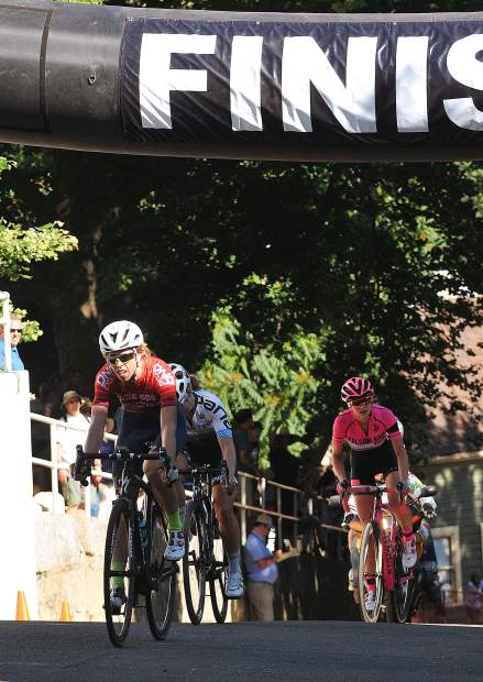 Women's pro race winner Lisa Cordova crosses the finish line first while Amity Gregg and Ellie Velez follow close behind for a second and third place finish during Sunday's Nevada City Classic bicycle races.