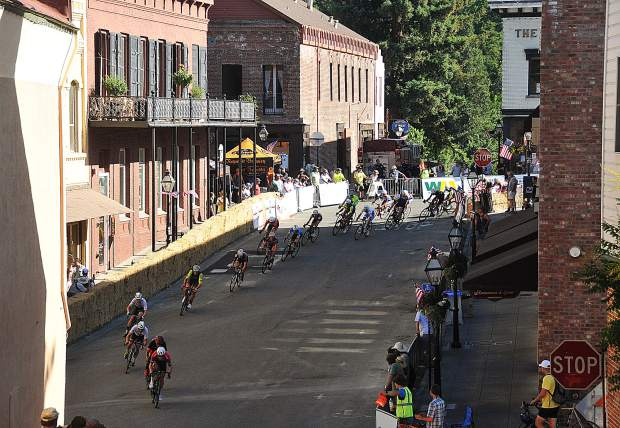 Racers make the turn down Broad Street and onto Pine Street during Sunday's races of the Nevada City Classic.