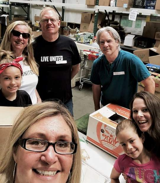 In the spirit of #NationalSelfieDay please see attached selfie taken during United Way volunteers including Megan Timpany, Executive Director of United Way, Board Member Greg Michna and volunteer Tom Myers helping during Day of Action.