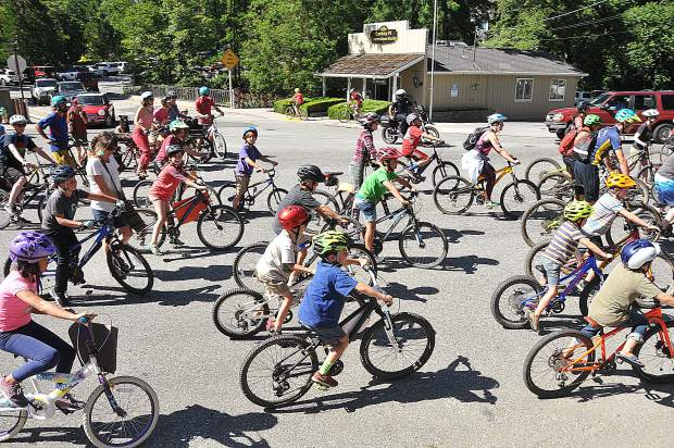 Over 75 area cyclists, the majority being area youth, ride along Broad Street en route to The Stone House after parading through the streets of Nevada City in opposition to racism.