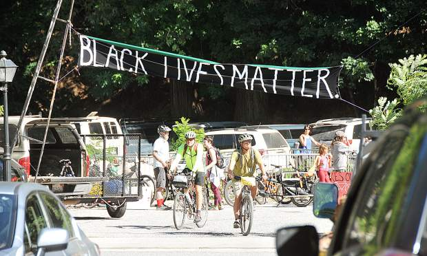 A Black Lives Matter sign is put up above the entrance of The Stone House following Friday's bike ride against racism.