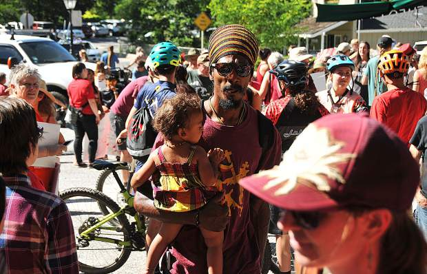 Folks of all ages, races, and backgrounds gathered in unity during Friday's ride against racism through the streets of downtown Nevada City.