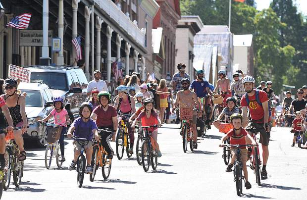 Nearly 100 bicyclists took to the streets of Nevada City Friday evening to denounce racism, riding in solidarity among one another before meeting at The Stone House for an evening of music and inspirational speeches.