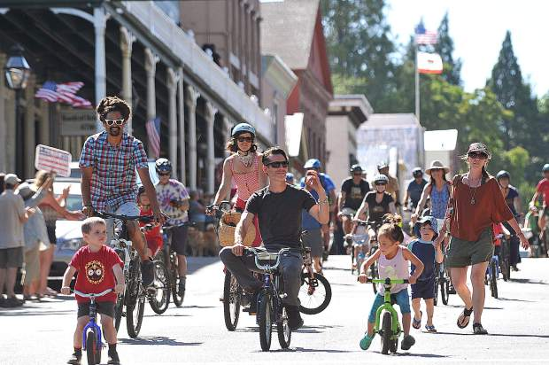Nearly 100 bicyclists took to the streets of Nevada City Friday evening to denounce racism, riding in solidarity before meeting at The Stone House for an evening of music and inspirational speeches.
