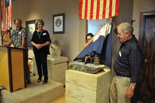 John Sargent, great grandson of U.S. Senator A.A. Sargent, unveils the miniature statue of what is planned to be a life-sized statue of the Sargents to be placed at the top of Broad Street in Nevada City in August of 2020.