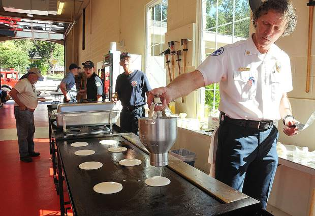 Rough and Ready Fire Chief Bob Vaughn helps make pancakes during the firefighter breakfast offered during Sunday's Secession Days in Rough and Ready.