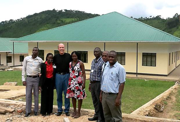 Staff members stand in front of the new Uganda Nursing School at the Bwindi Community Hospital, founded by Dr. Scott Kellermann through the generosity and support of the Nevada County community.