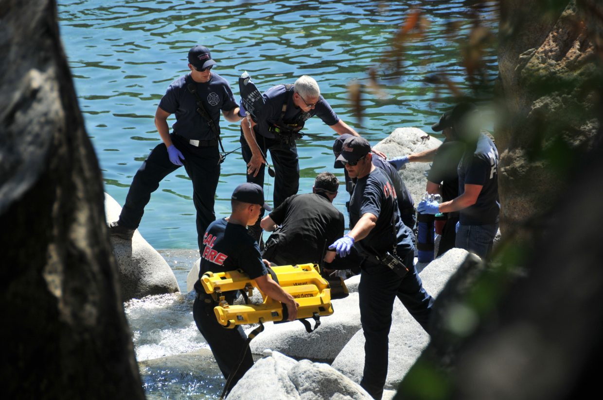 Nevada County first responders perform CPR on a drowning victim who was pronounced dead Tuesday afternoon at the South Yuba River, downstream from the Highway 49 bridge.