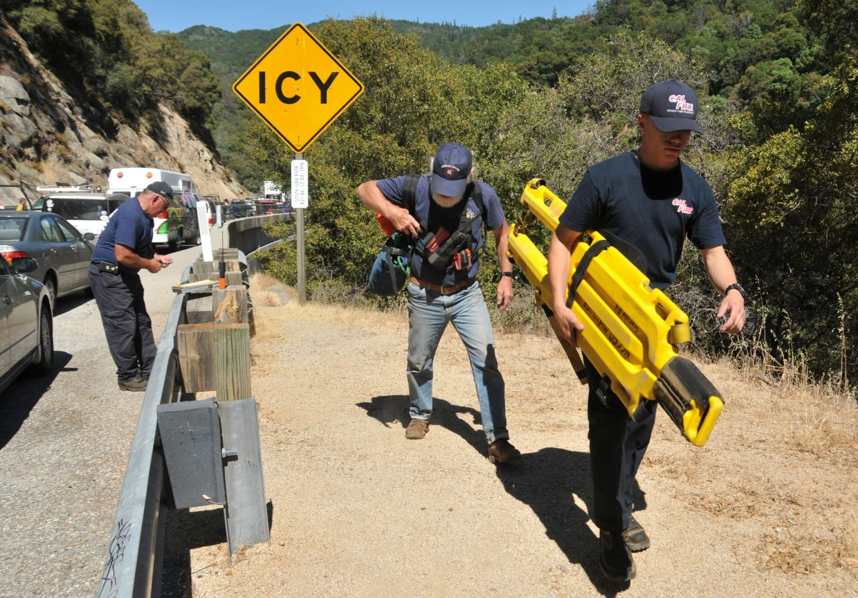 Cal Fire and North San Juan firefighters ready to make the steep hike down into the South Yuba River canyon to tend to a drowning victim.