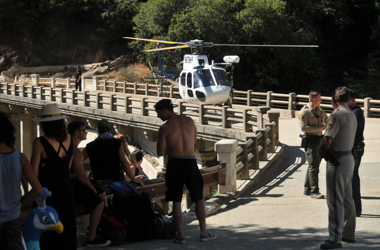 A CHP helicopter readies to lift off of the old Highway 49 bridge over the South Yuba River to aid in the recovery of the body after being pronounced dead at the scene Tuesday afternoon.