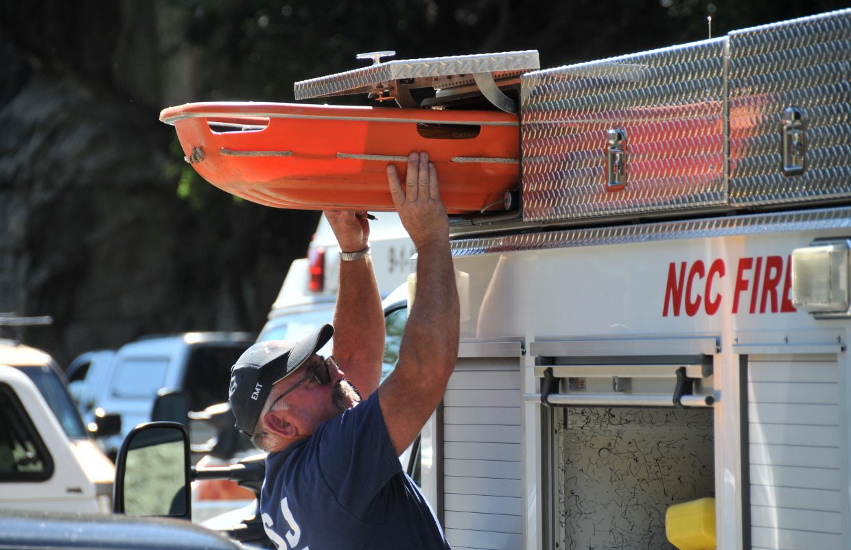 Firefighters ready a bucket to pull Tuesday's Yuba River drowning victim.