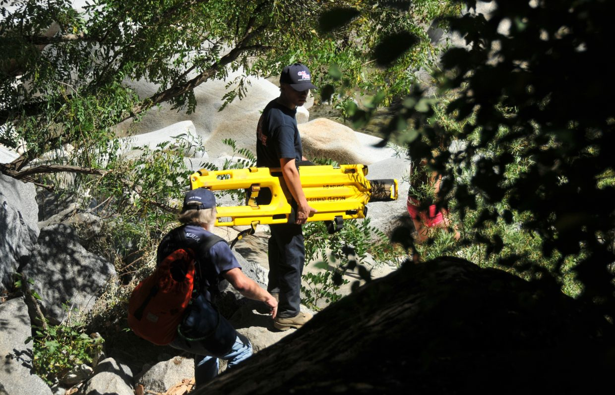 Firefighters descend into the steep South Yuba River canyon to access Tuesday's drowning victim.