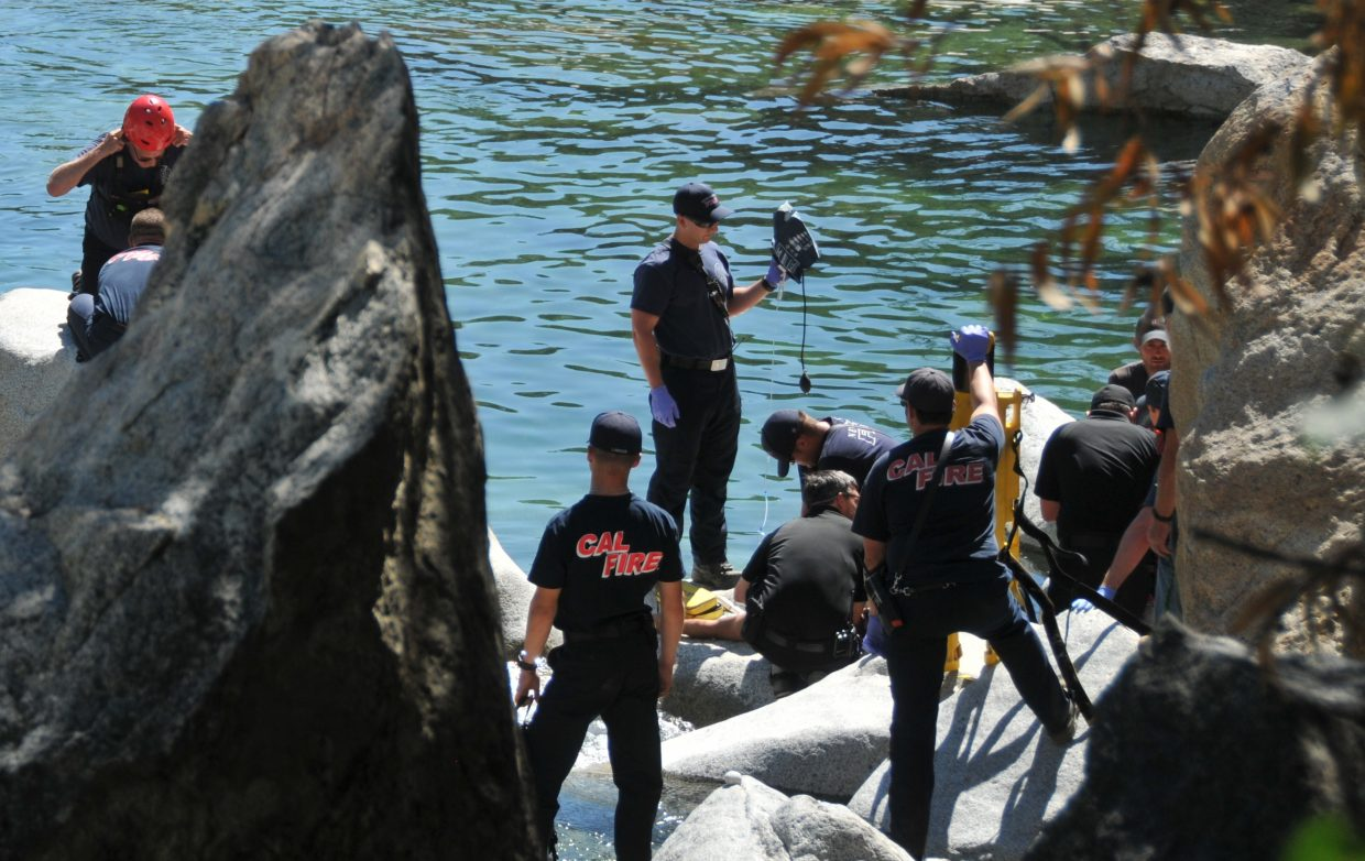 Nevada County first responders perform CPR on a drowning victim who was pronounced dead at the scene Tuesday afternoon at the South Yuba River downstream from the Highway 49 bridge.