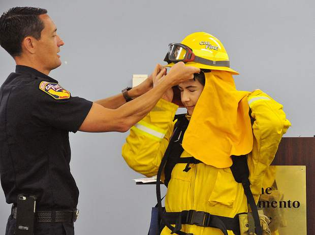Sacramento Bee breaking news reporter Julia Sclafani gets some help into fireproof nomex gear from CalFire PIO Jonathan Cox during a recent media wildfire training.