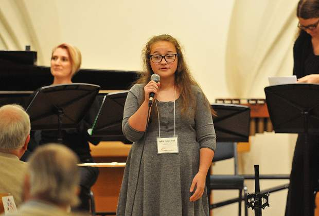 Lydia Fuller-Hall, 15, introduces her three-piece ensemble composition titled The Decision during Saturday's Young Composers Project concert. Fuller-Hall's song was inspired by the Yuba River due to Music in the Mountains' partnership with the South Yuba River Citizens League to help make the Young Composers Project a reality.