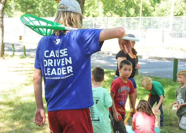 YMCA camp counselor Liam Spangenberg wears a shirt that reads